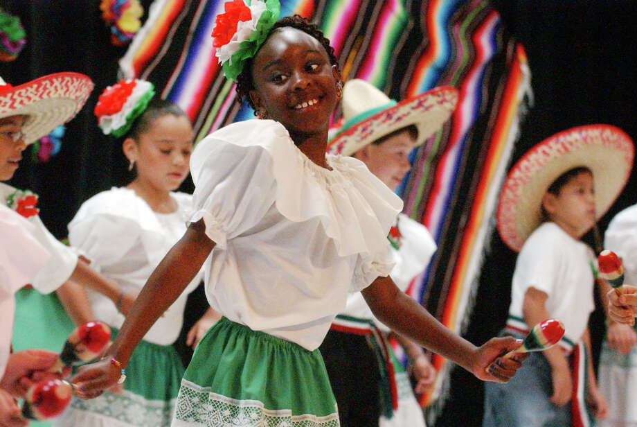 "San Antonio has embraced for many years this festivity that originally commemorated the Battle of Puebla and its evolution into a celebration of Hispanic Culture.In this file photo Lakeeanna Harris, 8, dances to ""Cielito Lindo: as Burke Elementary School bilingual students present their second annual Cinco de Mayo program of Mexican Heritage songs and dances.  Thursday May 5, 2005.  (Robert McLeroy/Staff) Photo: ROBERT McLEROY, SAN ANTONIO EXPRESS-NEWS / 2005 SAN ANTONIO EXPRESS-NEWS"