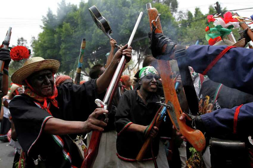 People take part in a recreation of the Battle of Puebla during