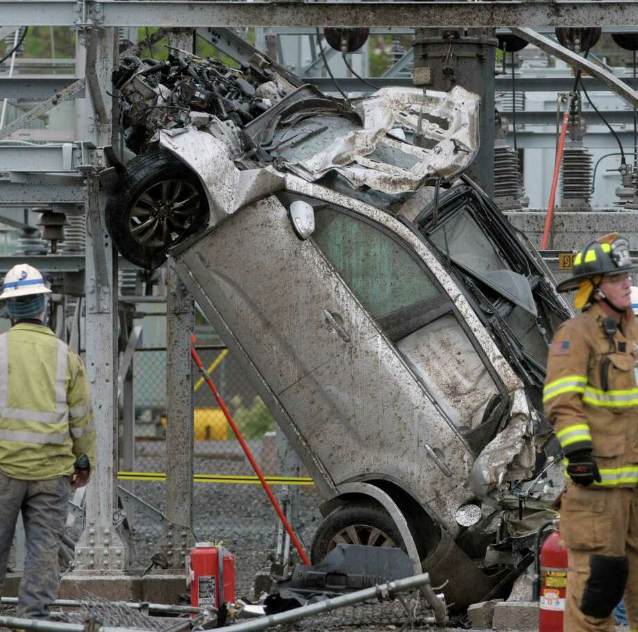 Firefighters and National Grid workers at the scene of a two vehicle accident that sent a car into a National Grid substation on Tuesday morning, May 1, 2012 in Menands, NY.  (Paul Buckowski / Times Union) Photo: Paul Buckowski