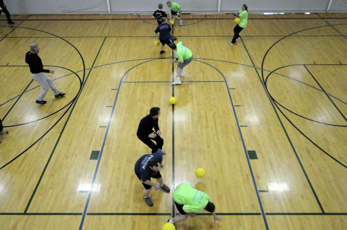 A team of Times Union representatives take on a pair of community teams in dodgeball at the YMCA in Guilderland N.Y. Saturday April 28, 2012. (Michael P. Farrell/Times Union)
