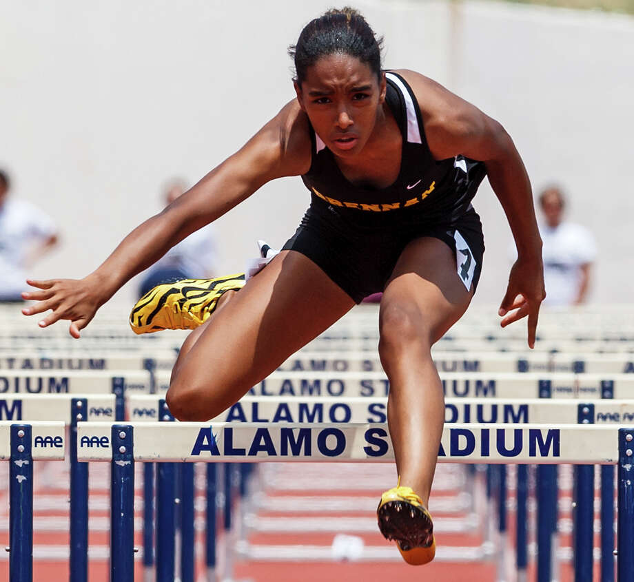 Brennan freshman Autym Scales clears the last hurdle in the 4A women's 100-meter hurdles during the Region IV Track & Field meet at Alamo Stadium on April 28, 2012.  Scales took home gold in the event with a time of 15.05 and also won the 300-meter hurdles with a time of 44.73. Photo: MARVIN PFEIFFER, Marvin Pfeiffer / Northwest Weekly / Prime Time Newspapers 2012