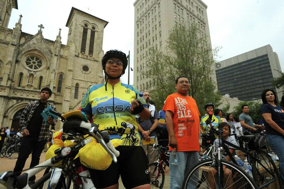 Sylvia Cortez, an employee of the City of San Antonio Development Services, stands with others in Main Plaza after riding her bike to work for the Walk & Roll to Work Rally. The event was an effort to encourage healthier lifestyles and alternative forms of transportation. May 20, 2011. BILLY CALZADA / gcalzada@express-news.net Photo: BILLY CALZADA, SAN ANTONIO EXPRESS-NEWS / gcalzada@express-news.net