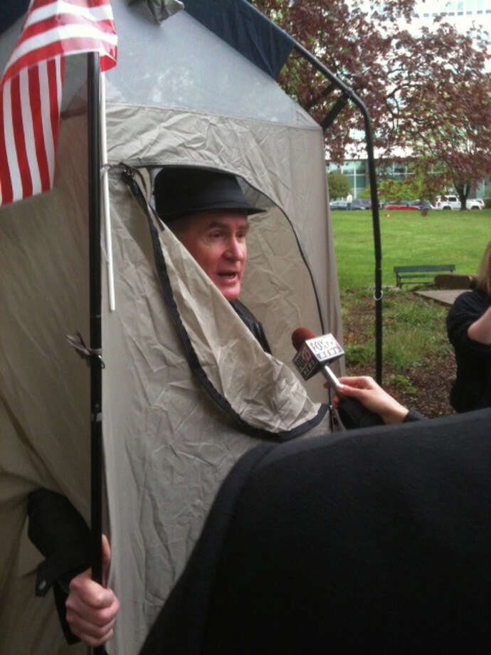 Occupy Albany protester Tom Rostocki pauses to talk to reporters as the group prepared to gather Tuesday, May, 2, 2012, in Lafayette Park in Albany. (Bryan Fitzgerald / Times Union)