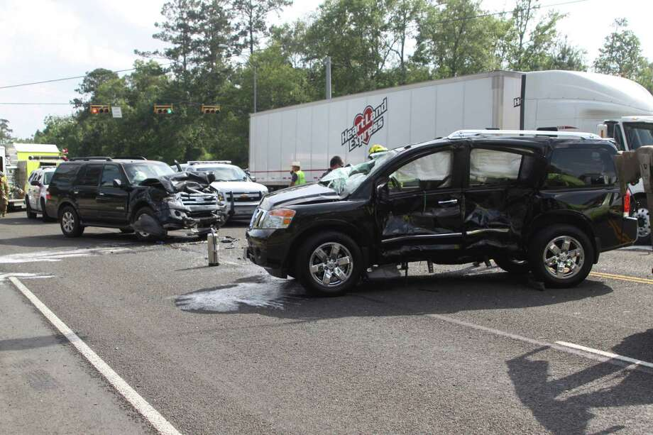 A two vehcile accident in Lumberton sent one person to the hospital and backed up evening traffic Friday. Photo: David Lisenby, HCN_Wreck 4-27