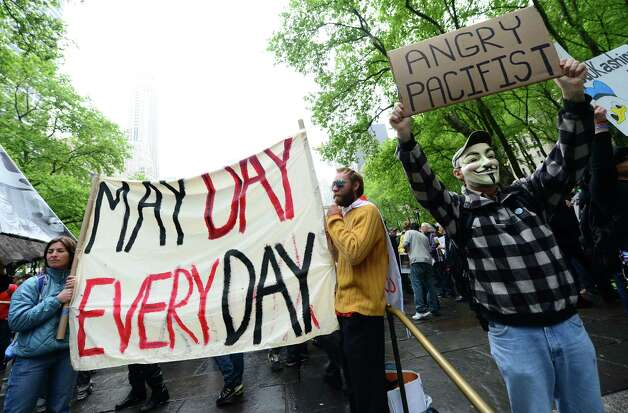 Occupy Wall Street partcipants gather to stage a May Day march at Bryant Park in New York. The Occupy movement that shook the United States last year, spawning similar protests worldwide, announced widespread May Day demonstrations and strikes against social inequality Tuesday. (EMMANUEL DUNAND/AFP/GettyImages) Photo: EMMANUEL DUNAND, AFP/Getty Images / 2012 AFP