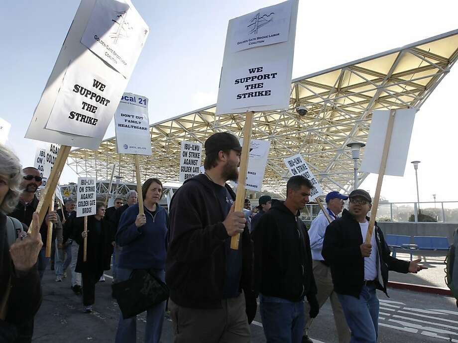 Striking transit workers and supporters march past the Golden Gate Transit ferry terminal in Larkspur, Calif. on Tuesday, May 1, 2012. Photo: Paul Chinn, The Chronicle