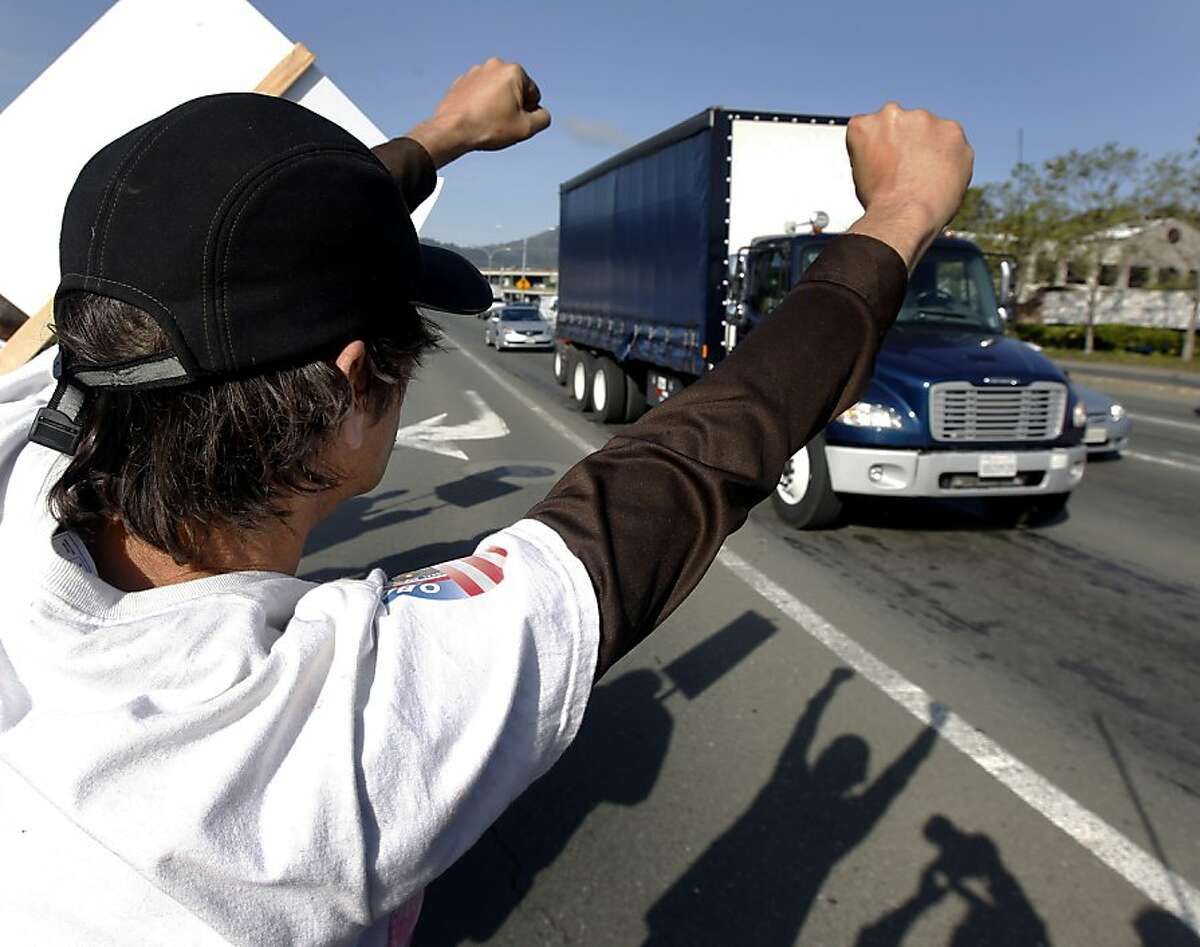 Mike McAfee seeks support from drivers on Sir Francis Drake Boulevard during a strike at the Golden Gate Transit ferry terminal in Larkspur, Calif. on Tuesday, May 1, 2012.