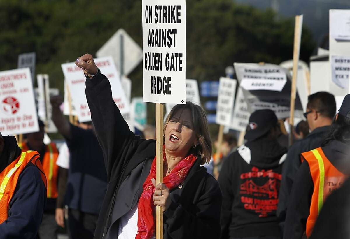 Union organizer Marina Secchitano walks a picket line during a strike at the Golden Gate Transit ferry terminal in Larkspur, Calif. on Tuesday, May 1, 2012.