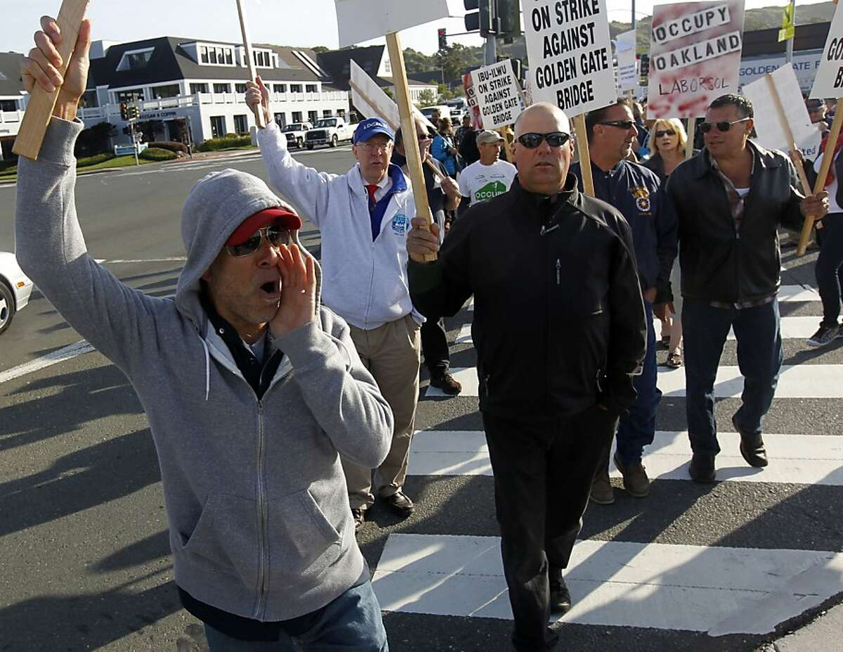 Bus driver Paul Canorro (left) leads a march during a strike at the Golden Gate Transit ferry terminal in Larkspur, Calif. on Tuesday, May 1, 2012.