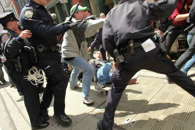 NEW YORK, NY - MAY 01:  A protester associated with the Occupy Wall Street movement is arrested while marching through traffic in lower Manhattan on May 1, 2012 in New York City. May 1st, Labor Day, is a traditional day of global protest in sympathy with union and leftist politics. Photo: Spencer Platt, Getty Images / 2012 Getty Images