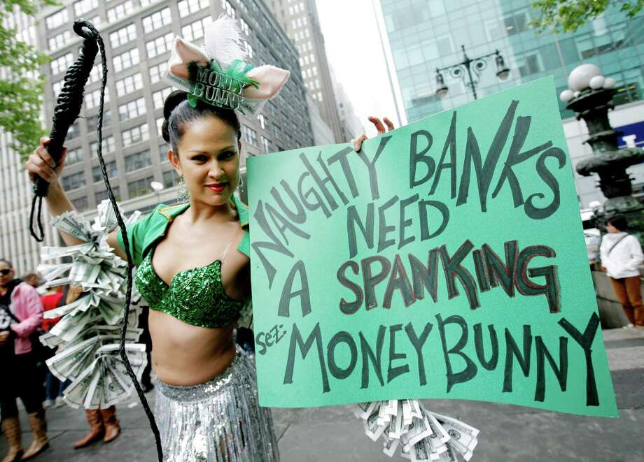 "Marni Halasa of New York dresses as the ""money bunny"" as she joins the Occupy Wall Street gathering during a May Day rally in Bryant Park in New York. Demonstrators have called for nation-wide May Day strikes to protest economic inequality and political corruption. Photo: Monika Graff, Getty Images / 2012 Getty Images"