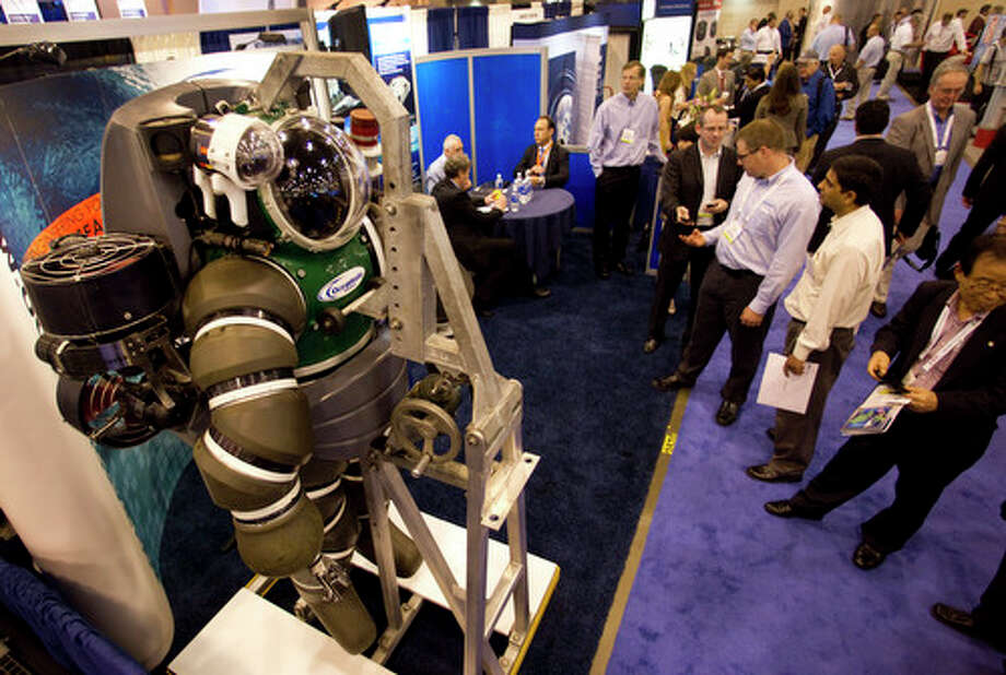The Hardsuit Quantum II diving system from Oceanworks International is shown on display during the 2012 Offshore Technology Conference Tuesday, May 1, 2012, in Houston. Photo: Brett Coomer, Houston Chronicle / © 2012 Houston Chronicle