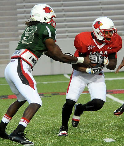 Jeremy Johnson hands off to Stephen Alfred during the Crawfish Bowl Spring game at Lamar University in Beaumont, Tuesday,  April 17, 2012. Tammy McKinley/The Enterprise Photo: TAMMY MCKINLEY