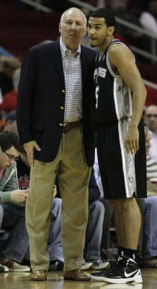 San Antonio Spurs head coach Gregg Popovich, left, talks to San Antonio Spurs guard Cory Joseph (5) during the first half of a pre-season NBA basketball game against the Houston Rockets at Toyota Center Saturday, Dec. 17, 2011, in Houston. ( Brett Coomer / Houston Chronicle ) (Chronicle)