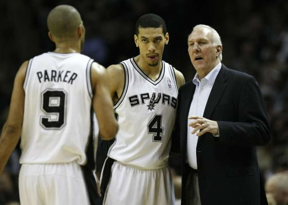 FOR SPORTS - San Antonio Spurs head coach Gregg Popovich talks with San Antonio Spurs guard Tony Parker (9) and San Antonio Spurs guard Danny Green (4) during first half action Thursday Jan. 5, 2012 at the AT&T Center.  (PHOTO BY KEVIN MARTIN/kmartin@express-news.net) (KEVIN MARTIN / SAN ANTONIO EXPRESS-NEWS)