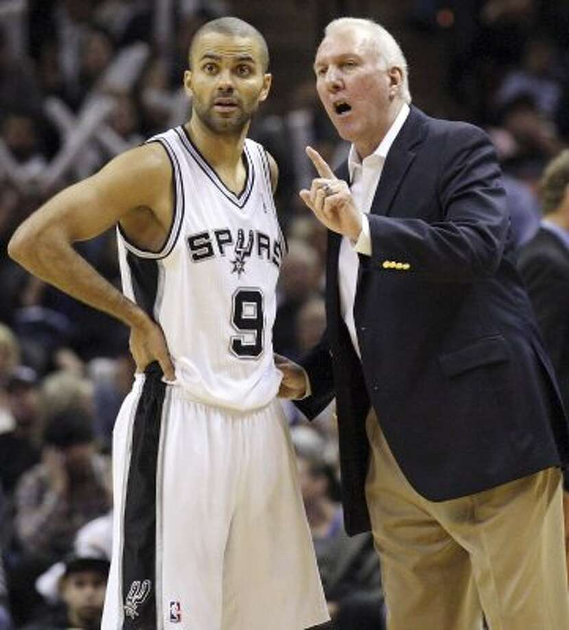 San Antonio Spurs' Tony Parker (left) talks with San Antonio Spurs' head coach Gregg Popovich during second half action against the Denver Nuggets Saturday Jan. 7, 2012 at the AT&T Center. The Spurs won 121-117.  (PHOTO BY EDWARD A. ORNELAS/eaornelas@express-news.net) (SAN ANTONIO EXPRESS-NEWS)