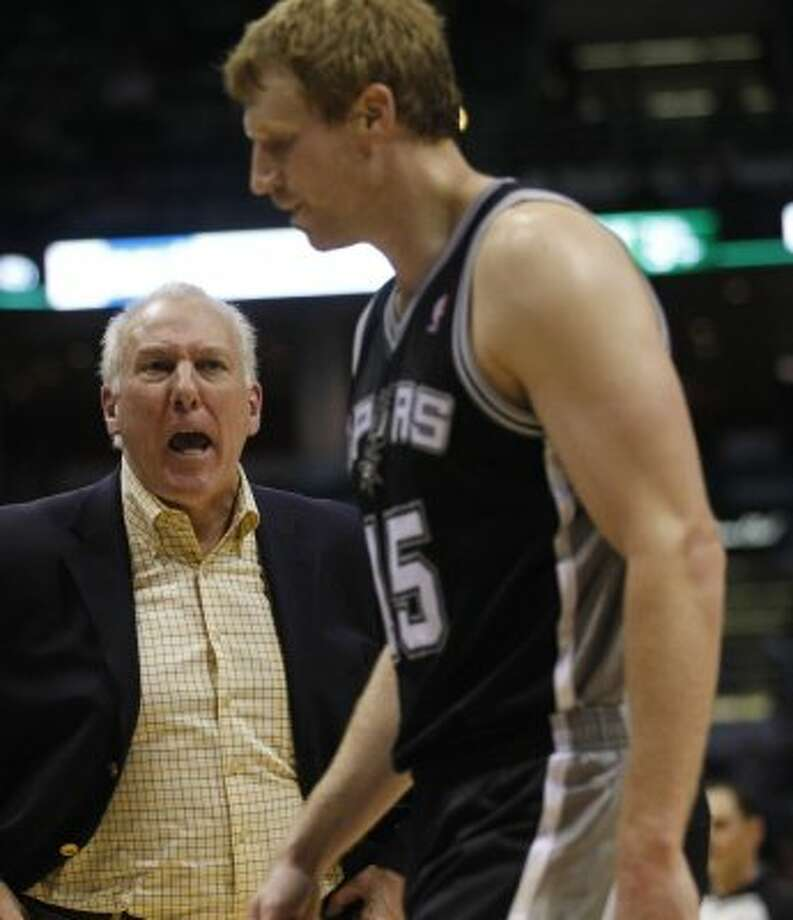 San Antonio Spurs head coach Gregg Popovich, left, yells at Matt Bonner (15) during a time out against the Milwaukee Bucks during the second half of an NBA basketball game, Tuesday, Jan. 10, 2012, in Milwaukee. The Bucks won 106-103.  (AP Photo/Jeffrey Phelps) (AP)