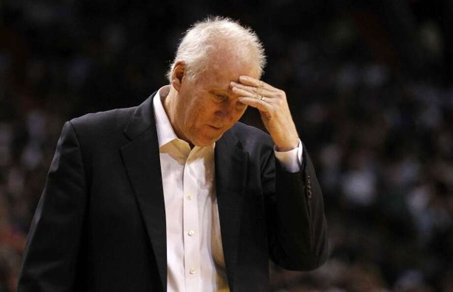 San Antonio Spurs head coach Gregg Popovich reacts during a game against the Miami Heat at American Airlines Arena on January 17, 2012 in Miami, Florida. NOTE TO USER: User expressly acknowledges and agrees that, by downloading and/or using this Photograph, User is consenting to the terms and conditions of the Getty Images License Agreement.  (Photo by Mike Ehrmann/Getty Images) (Getty Images)