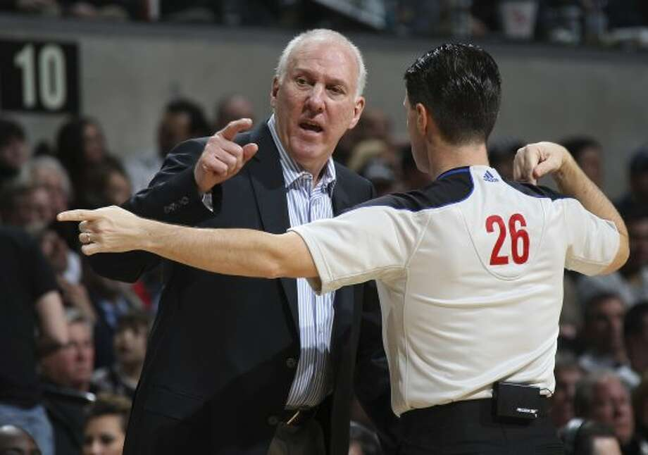 SPURS -- San Antonio Spurs Head Coach Gregg Popovich talks with official Pat Fraher during the first half against the Atlanta Hawks at the AT&T Center, Wednesday, Jan. 25, 2012. Jerry Lara/San Antonio Express-News (San Antonio Express-News)