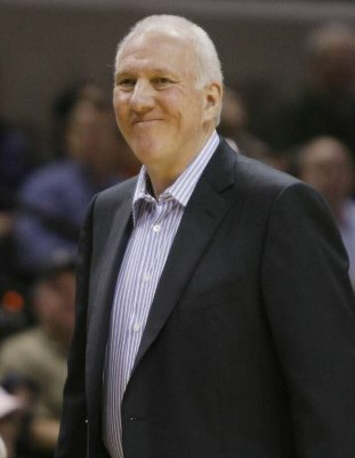 San Antonio Spurs head coach Gregg Popovich watches play during the second half of an NBA basketball game against the Atlanta Hawks, Wednesday, Jan. 25, 2012, at the AT&T Center in San Antonio. San Antonio won 105-83. (AP Photo/Darren Abate) (AP)
