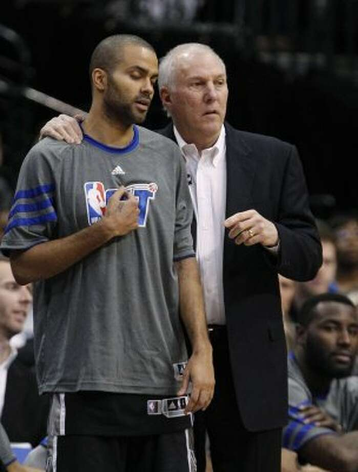 San Antonio Spurs point guard Tony Parker (9) closes his eyes and listens to coach Gregg Popovich during the second half of an NBA basketball game against the Dallas Mavericks in Dallas, Sunday, Jan. 29, 2012. The Mavericks won 101-100 in overtime. (AP Photo/LM  Otero) (AP)