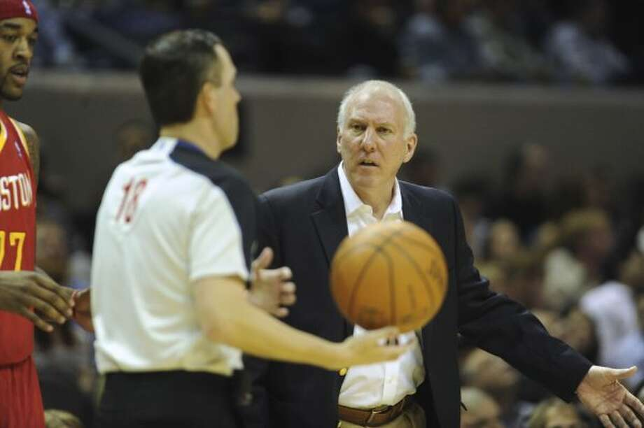San Antonio Spurs coach Gregg Popovich questions a call by official Matt Boland during first-half NBA action against the Houston Rockets at the AT&T Center on Wednesday, Feb. 1, 2012.  Billy Calzada / San Antonio Express-News