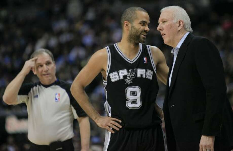 San Antonio Spurs point guard Tony Parker (9) and head coach Gregg Popovich, right, talk on the sideline during the second quarter of an NBA basketball game against the Denver Nuggets, Thursday, Feb. 23, 2012, in Denver. (AP Photo/Barry Gutierrez) (AP)