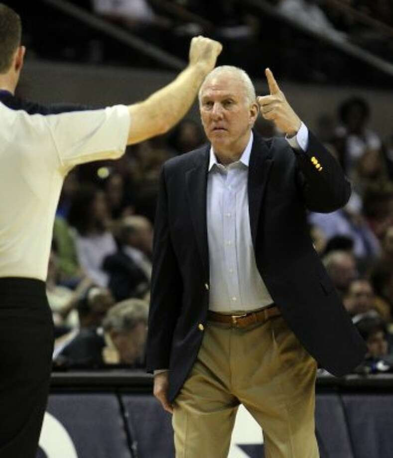 Spurs coach Gregg Popovich points out a call to a game official during their game against the Charlotte Bobcats at the AT&T Center on Friday, Mar. 2, 2012. Kin Man Hui/San Antonio Express-News (Kin Man Hui / San Antonio Express-News)
