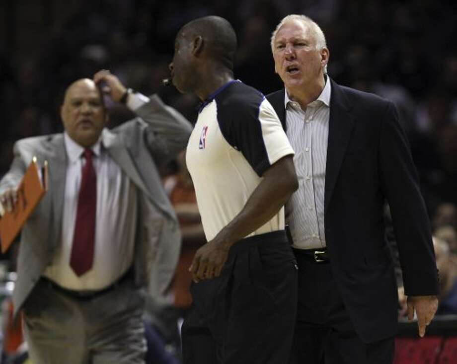 SPURS -- San Antonio Spurs Head Coach Gregg Popovich follows official James Williams before he is ejected during the second half against the New York Knicks at the AT&T Center, Wednesday, March 7, 2012. The Spurs won 118-105. In back is Assistant Coach Don Newman. Jerry Lara/San Antonio Express-News (San Antonio Express-News)