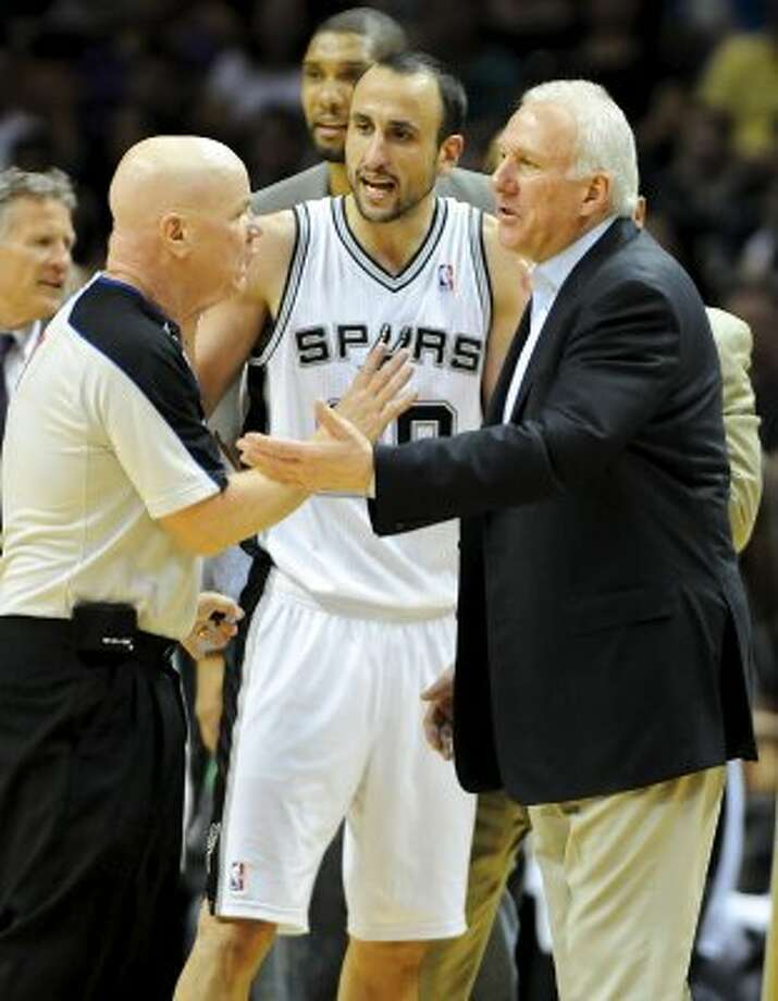 San Antonio Spurs shooting guard Manu Ginobili (20) and San Antonio Spurs head coach Gregg Popovich argue with referee Joe Crawford (left) during a NBA basketball game between the Philadelphia 76ers and the San Antonio Spurs at the AT&T Center in San Antonio, Texas on March 25, 2012. John Albright / Special to the Express-News. (San Antonio Express-News)