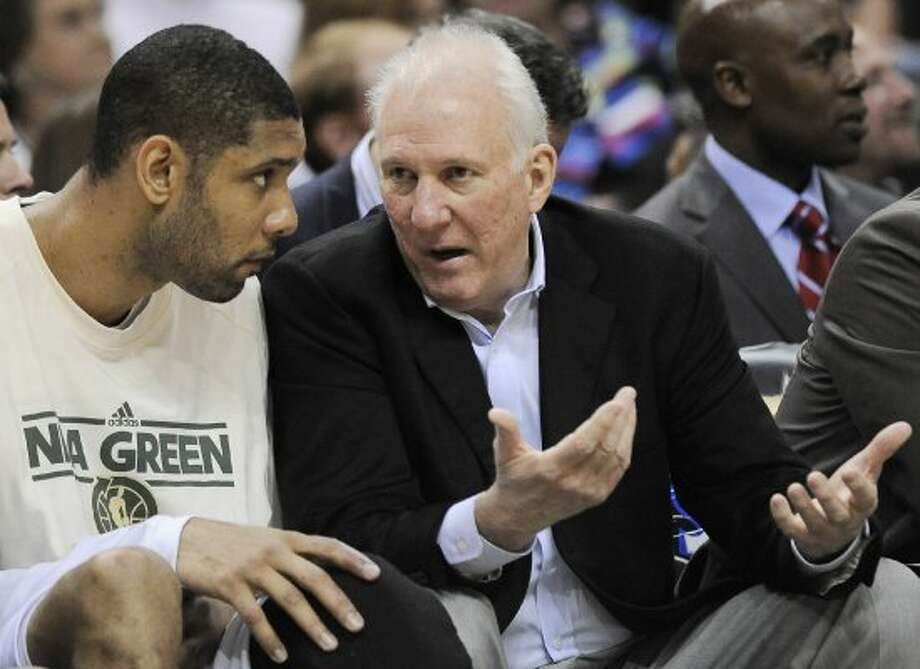 San Antonio Spurs head coach Gregg Popovich, right, talks to  Tim Duncan during the second half of an NBA basketball game against the New Orleans Hornets, Friday, April 6, 2012, in San Antonio. San Antonio won 128-103. (AP Photo/Darren Abate) (AP)