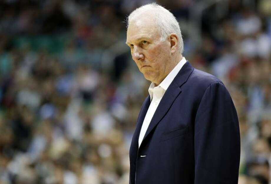 San Antonio Spurs coach Gregg Popovich watches his team during the second half of an NBA basketball game against the Utah Jazz on Monday, April 9, 2012, in Salt Lake City. The Jazz won 91-84. (AP Photo/Jim Urquhart) (AP)