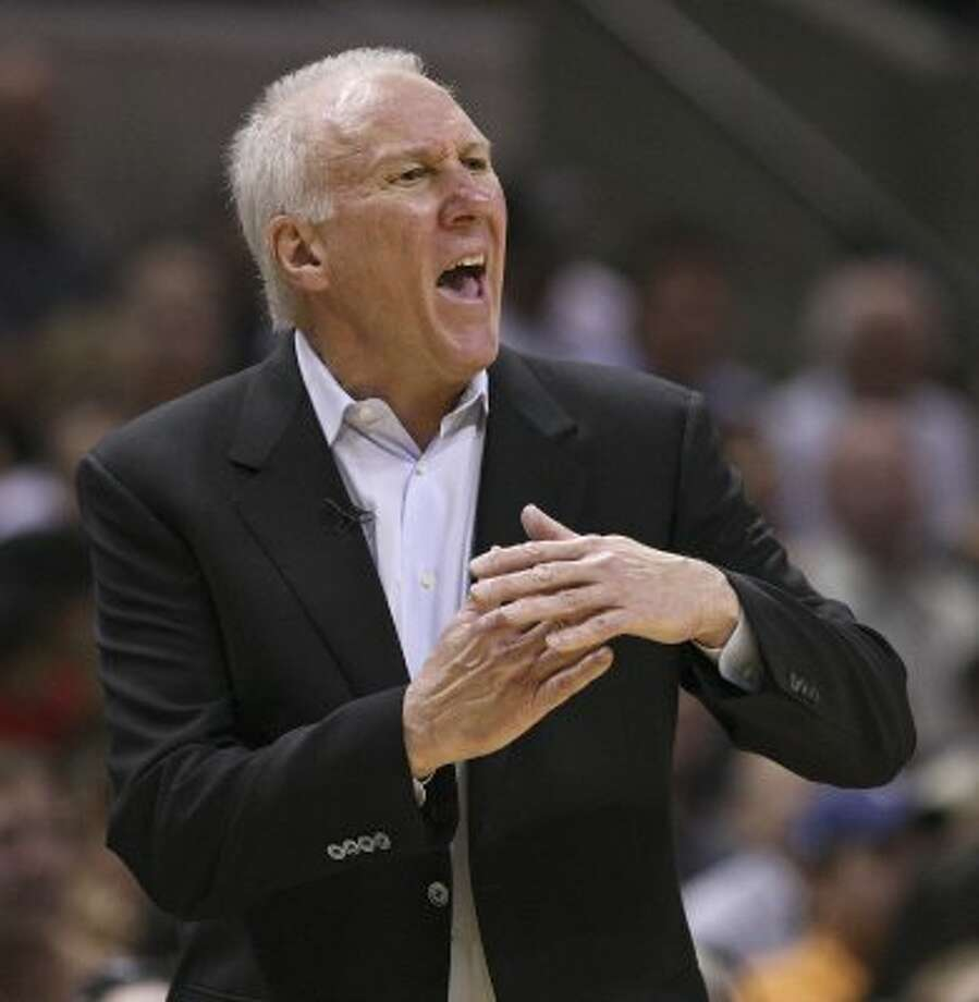 FOR SPORTS - San Antonio Spurs head coach Gregg Popovich calls for a timeout during second half action of Game 1 of the Western Conference first round against the Utah Jazz Sunday April 29, 2012 at the AT&T Center. The Spurs won 106-91.  (PHOTO BY EDWARD A. ORNELAS/SAN ANTONIO EXPRESS-NEWS) (SAN ANTONIO EXPRESS-NEWS)