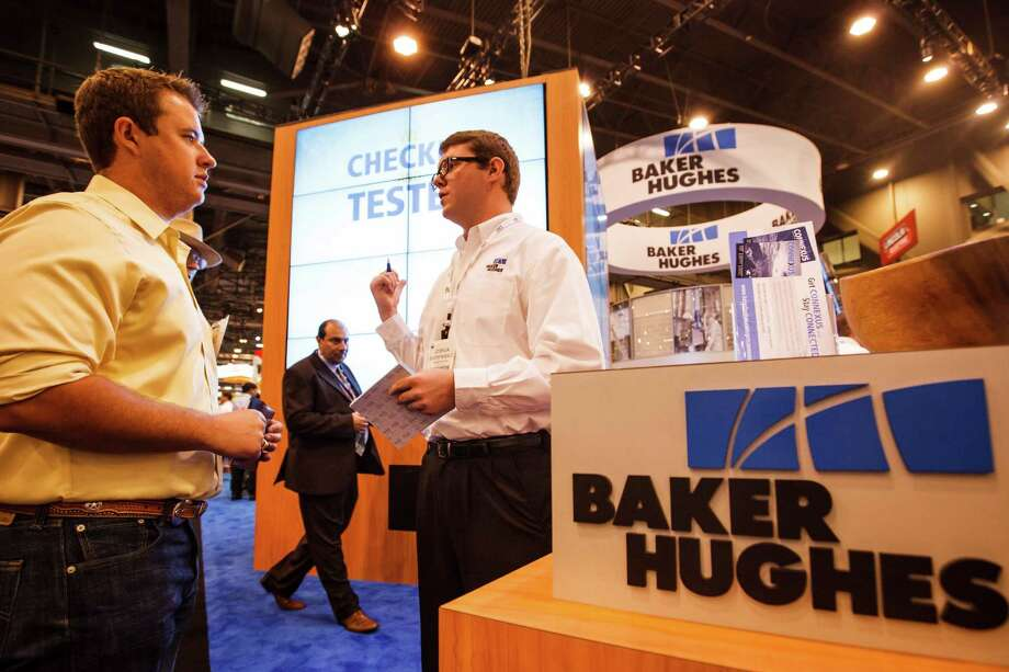 Kyle Harris (left) talks to Joshua Baerenwald about job opportunities at the Baker Hughes booth during the 2012 Offshore Technology Conference at Reliant Park, Tuesday, May 1, 2012, in Houston. Photo: Michael Paulsen, Houston Chronicle / © 2012 Houston Chronicle