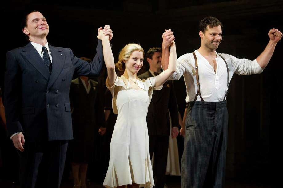 """FILE - In this March 12, 2012 file photo, from left, Michael Cerveris, Elena Roger and Ricky Martin appear at the curtain call after their first performance in the new Broadway production of """"Evita"""" in New York. Martin commands the stage with an air of confidence, yet the Latin superstar admitted Thursday, April 5, to being self-conscious at times. Photo: AP"""