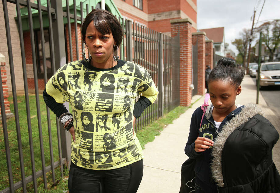 Lisa McDowell stands with her daughter, Zemeriah, 10, a fifth grader, after picking her up at Bryant School in Bridgeport on Tuesday, May 1, 2012. McDowell said she thinks the area around the school needs beefed up security, after a three-year-old girl was wounded in a gang shootout outside the school on Monday. Photo: Brian A. Pounds / Connecticut Post
