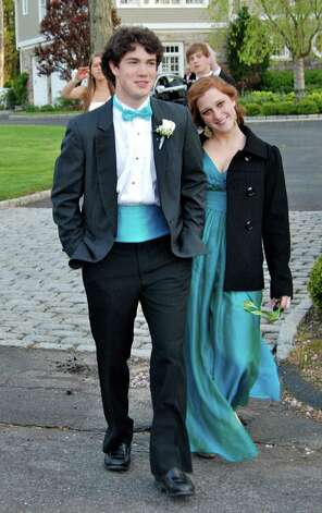 Chris Taylor and Avery Anthony leave the pre-prom party for the Junior Prom at the Italian Center.  Photo by Savannah Shepard. Photo: Contributed Photo