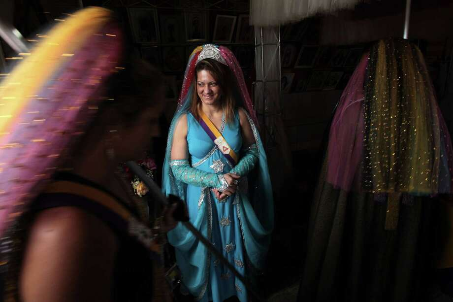 Women attend the ritual of the ellipse at the annual festival of the Vale do Amanhecer, or Sunrise Valley Festival, in Planaltina, Brazil, Tuesday, May 1, 2012. Vale do Amanhecer is a spiritual community founded in 1959 by the medium Tia Neiva and its doctrine contains elements from Christianity, Spiritualism, Mysticism, Afro-Brazilian religions and ancient Egyptian beliefs. The community has more than 600 temples throughout Brazil and other countries. (AP Photo/Eraldo Peres) Photo: Eraldo Peres, Associated Press / AP