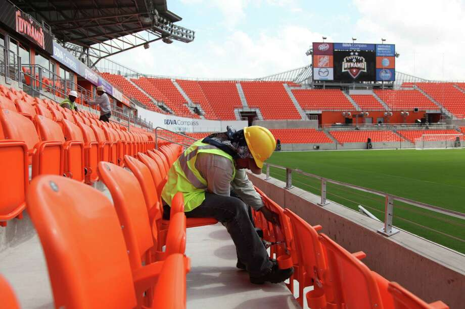 Alvarado Luis assembles armrests for a couple of seats at the new BBVA Compass Stadium as they prepare for Opening Day May 12th, 2012. Photo take after ribbon-cutting ceremony on Tuesday, May 1, 2012, in Houston. Photo: Mayra Beltran, Houston Chronicle / © 2012 Houston Chronicle