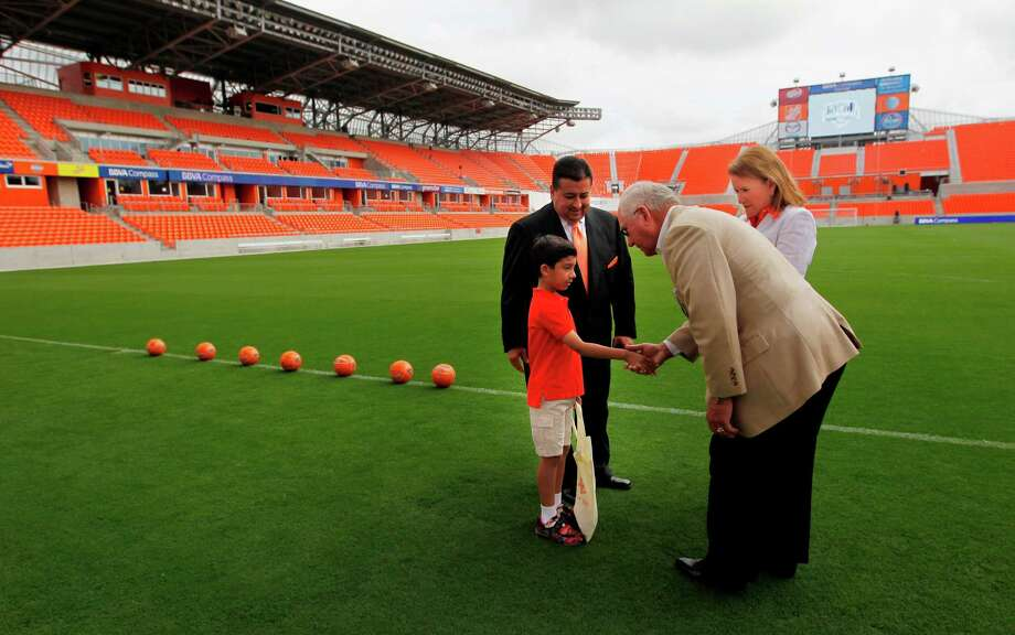 Gregory Compean, Harris County Houston Sports Authority Board of Director member, looks at son Gregory Compean greet Lawrence Catuzzi, HCHSA Board of Directors, and Sylvia Garcia, former Harris County Precinct Two Commisioner, prior to the Houston Dynamo and BBVA Compass Stadium ribbon-cutting ceremony on Tuesday, May 1, 2012, in Houston. Photo: Mayra Beltran, Houston Chronicle / © 2012 Houston Chronicle