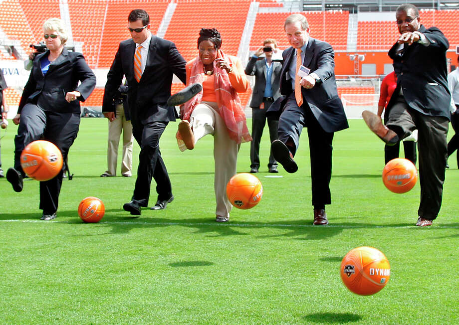 U.S. Rep. Sheila Jackson Lee (center)  loses her shoe while  Houston Mayor Annise Parker (left-right), Houston  Dynamo President Chris Canetti,  U.S. Rep. Sheila Jackson Lee, Kent Friedman, Chairman of the Board Harris County Houston Sports Authority and El Franco Lee, Harris County Precinct One Commissioner kick soccer balls into the net during the Houston Dynamo and BBVA Compass Stadium ribbon-cutting ceremony on Tuesday, May 1, 2012, in Houston. Photo: Mayra Beltran, Houston Chronicle / © 2012 Houston Chronicle