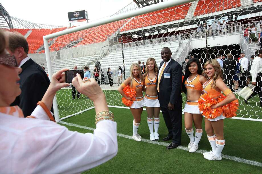 Matthew Rogers, HCHSA Board of Directors, is photographed with Dymano Girls (left to right) Taylor, Melissa, Tina, and Sara, at the end of the Houston Dynamo and BBVA Compass Stadium ribbon-cutting ceremony on Tuesday, May 1, 2012, in Houston. Photo: Mayra Beltran, Houston Chronicle / © 2012 Houston Chronicle