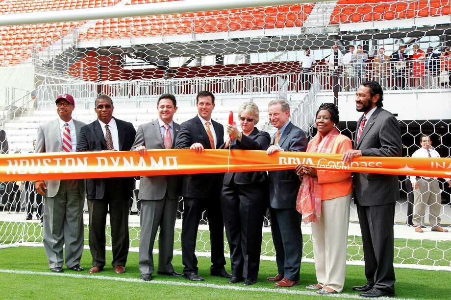 Dr. John Rudley, President of Texas Southern University, El Franco Lee, Harris County Precinct One Commissioner, James Rodriguez, City Council, Chris Canetti, Dynamo President of Business Operations,  Mayor Annise Parker, Kent Friedman, Chairman of the Board Harris County Houston Sports Authority, Houston Rep. Sheila Jackson Lee, Rep. Al Green participate in the Houston Dynamo and BBVA Compass Stadium ribbon-cutting ceremony on Tuesday, May 1, 2012, in Houston. Photo: Mayra Beltran, Houston Chronicle / © 2012 Houston Chronicle