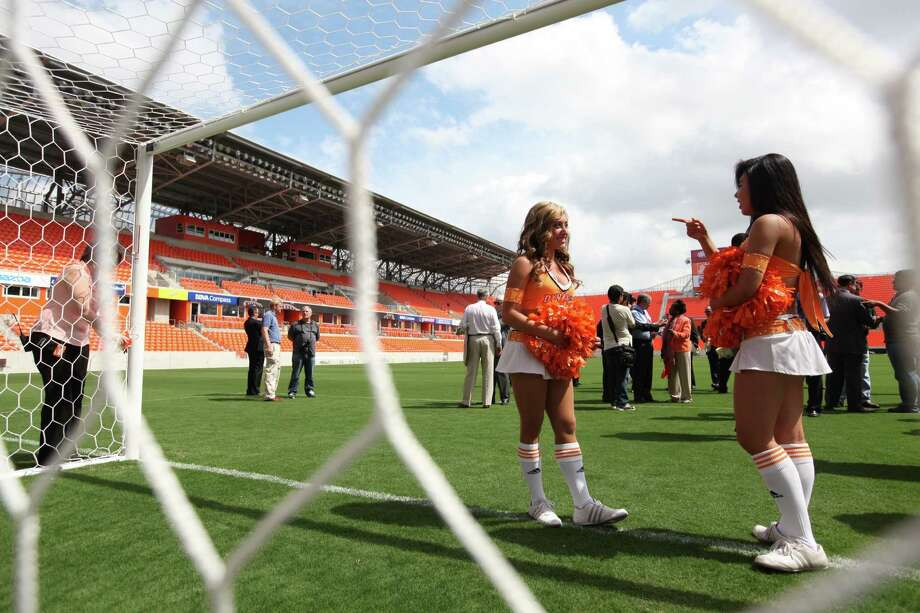 Dymano Girls Sara and Tina chat at the goal post at the conclusion of the Houston Dynamo and BBVA Compass Stadium ribbon-cutting ceremony on Tuesday, May 1, 2012, in Houston. Photo: Mayra Beltran, Houston Chronicle / © 2012 Houston Chronicle