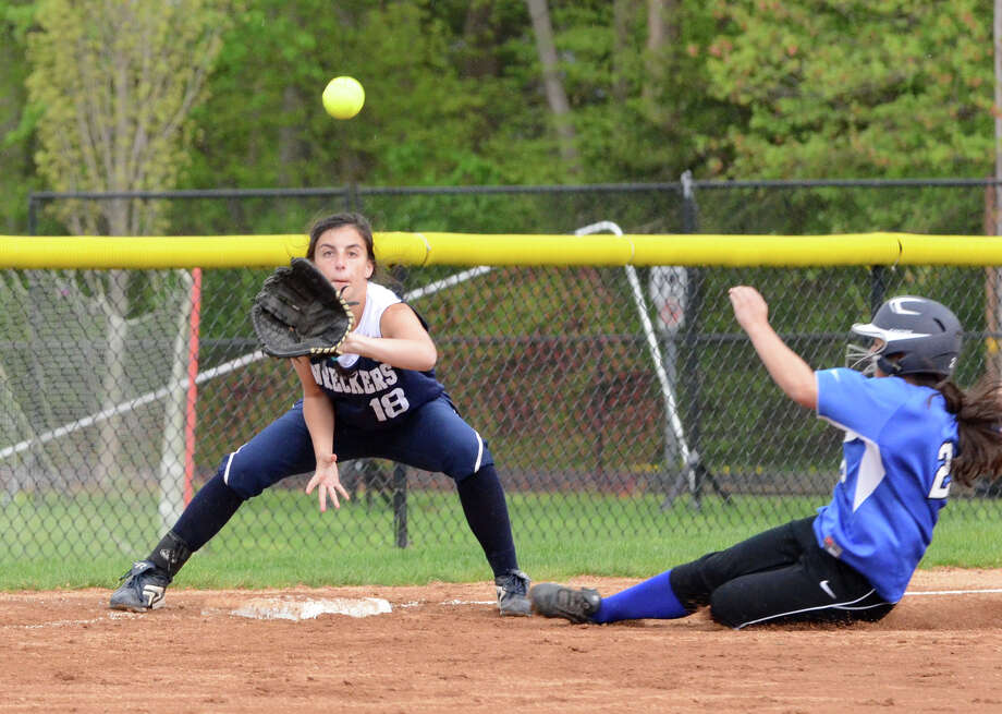 Staples' Shelby Schulman receives a throw against Darien last Wednesday. Schulman had two hits Monday in a 6-4 loss at Fairfield Photo: Amy Mortensen, Amy Mortensen / For The Westport News / Stamford Advocate Freelance