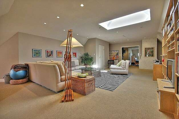 The refinished attic level also includes a family room. Photo: Blu Photography