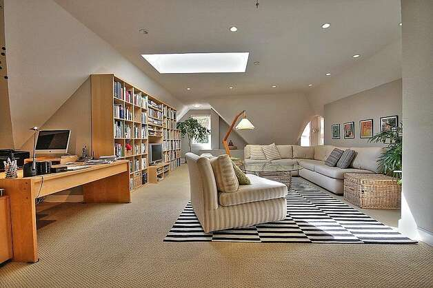 A large skylight tops the top level family room. Photo: Blu Photography