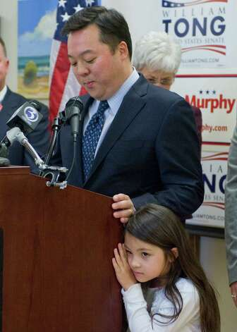 State Rep. William Tong, D-Stamford, announces he is dropping out of the race for U.S. Senate as his daughter Eleanor stands by his side, at a news conference at Goodwin College in East Hartford, Conn., Tuesday, May 1, 2012.  Tong said he is throwing his support behind one-time rival U.S. Rep. Chris Murphy.   (AP Photo/Jessica Hill) Photo: Jessica Hill, Associated Press / AP2012