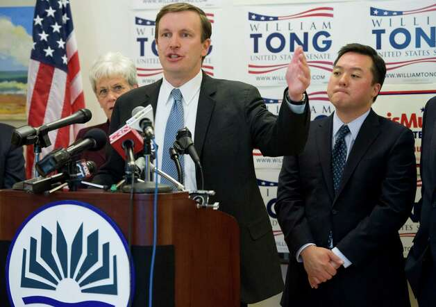 U.S. Rep. Chris Murphy, D-Conn., gestures while speaking as Lt. Gov. Nancy Wyman, left, and State Rep. William Tong, D-Stamford, right looks on at a news conference at Goodwin College in East Hartford, Conn., Tuesday, May 1, 2012.  Tong announced he is dropping out of the race for U.S. Senate and endorsed Murphy. (AP Photo/Jessica Hill) Photo: Jessica Hill, Associated Press / AP2012
