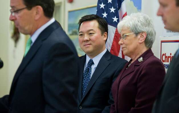 State Rep. William Tong, D-Stamford, center, listens as Gov. Dannel P. Malloy, left, announces his endorsement for Chris Murphy as Lt. Gov Nancy Wyman, second from right, and Chris Murphy, right, listen at Goodwin College in East Hartford, Conn., Tuesday, May 1, 2012.  Tong announced at the news conference he is dropping out of the race for U.S. Senate and endorsing Chris Murphy. (AP Photo/Jessica Hill) Photo: Jessica Hill, Associated Press / AP2012